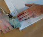 Canvas being stretched on a wooden frame