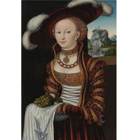 Portrait of a young lady holding grapes and apples